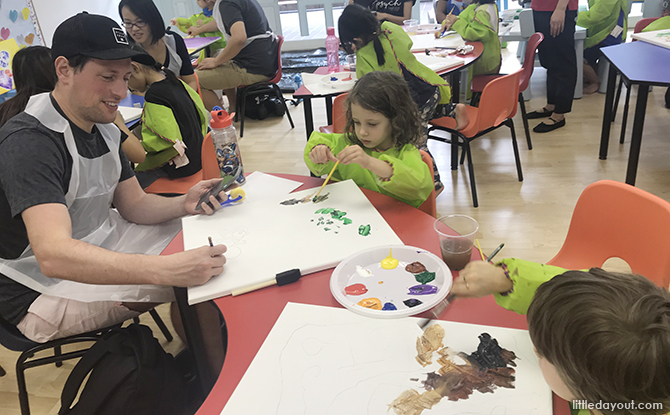 Parent and child making art together