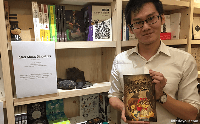 Andy Chua with his Mad About Dinosaurs Book