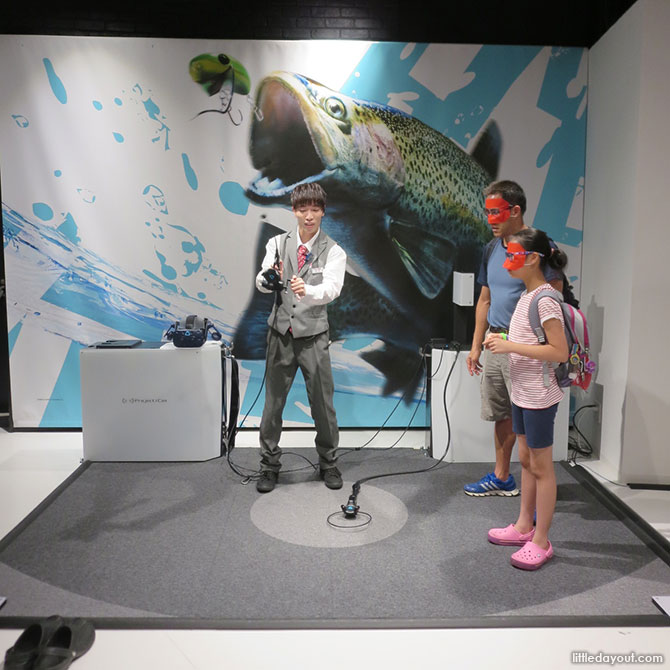 Staff teaching us how to fish at the VR Zone Osaka