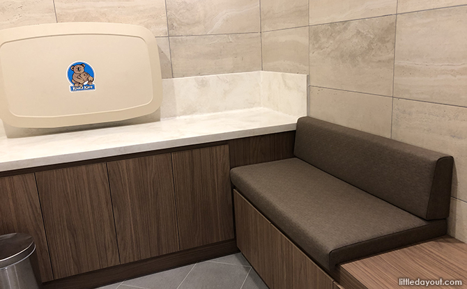 cushioned bench and baby changing station