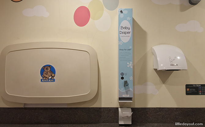 diaper changing station and diaper dispenser