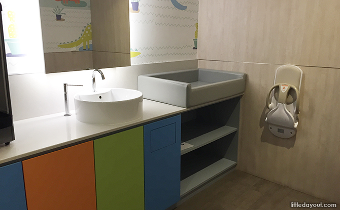 sink and padded diaper changing station