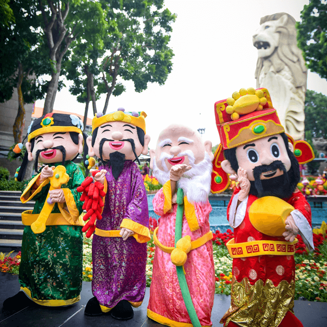 Meet festivity characters such as the God of Fortune at Sentosa's Merlion Plaza during Chinese New Year 2018
