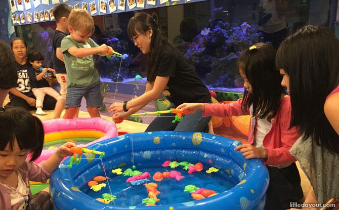 Families enjoyed bonding moments at the fishing activity station.