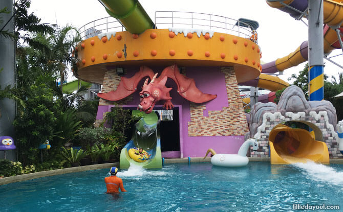 At the end of the magical ride. Lifeguards are stationed at slide exits to ensure the safety of park guests.