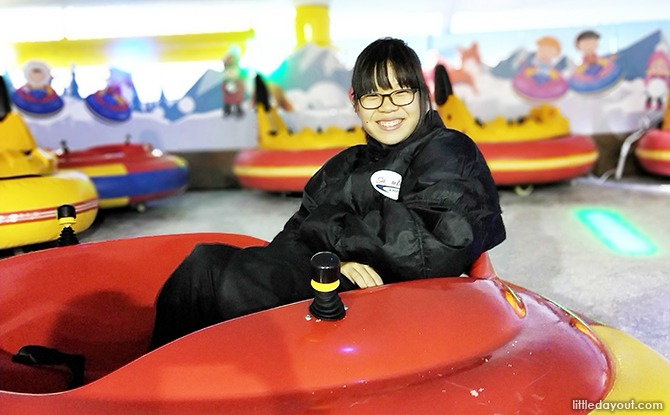 Woman in bumper car, Drift on Ice