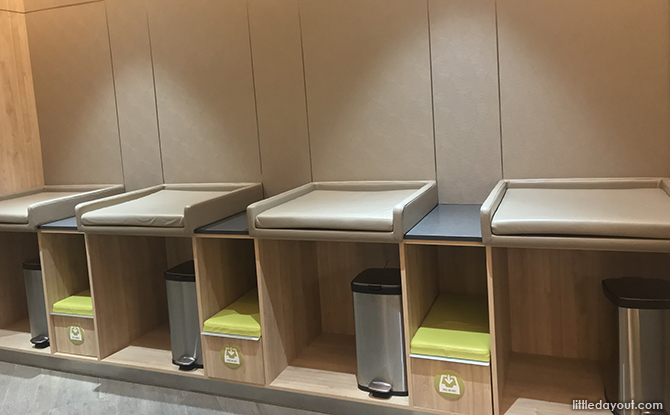 Padded diaper changing stations