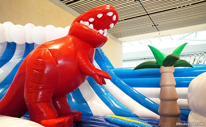 Surfing T-rex at the Changi Festive Village Dino Bouncy Castle