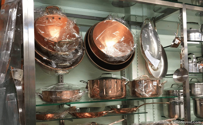 Shiny pans on display at Sia Huat
