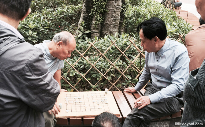 Old men playing chess.