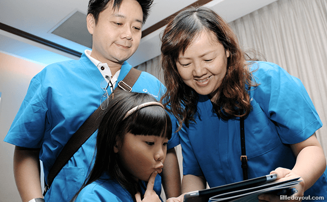 (Clockwise from left) Alvin Wang, his wife Joanne Ng and daughter Alyssa solve puzzles together.