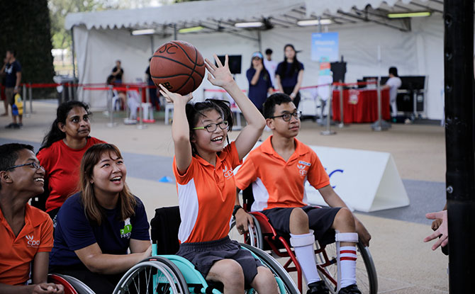 Participants having fun with Wheelchair Basketball