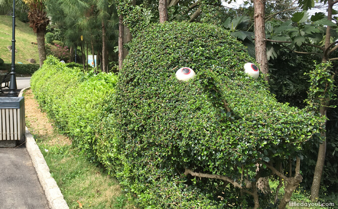 Cute dragon-shaped trimmed bushes caught the little one's attention.