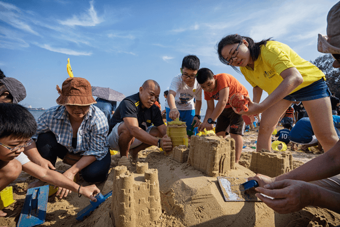 Learning teamwork through sandcastle building at Castle Beach