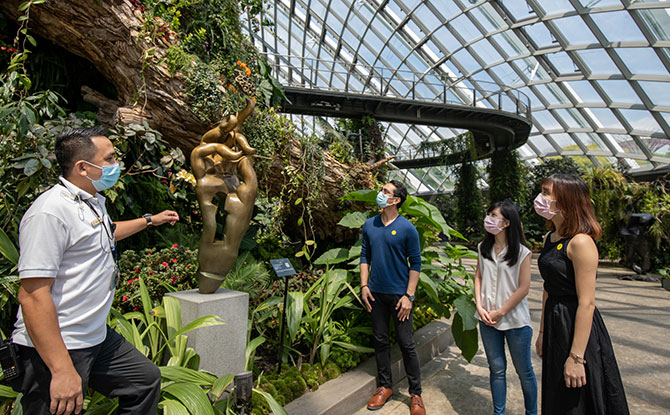 "A Gardens by the Bay staff shows nurses from National University Hospital one of the sculptures of ""A Sculptor's Secret Garden"", the first full-scale art exhibition in Cloud Forest on Nurses' Day."