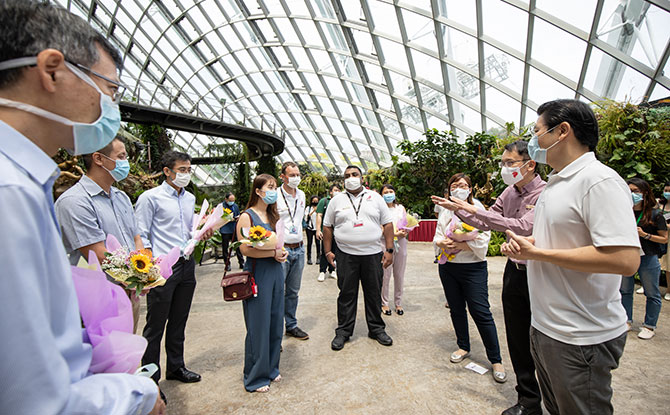 Minister for Education Lawrence Wong (right), who is co-chair of the multi-ministry task force for Covid-19, together with Gardens by the Bay CEO Felix Loh (second from right), meet with nurses and doctors from National University Hospital.